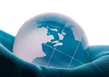 Blue globe on blue satin photo