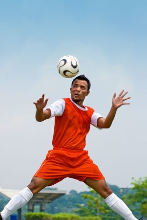 Football player in action - heading photo