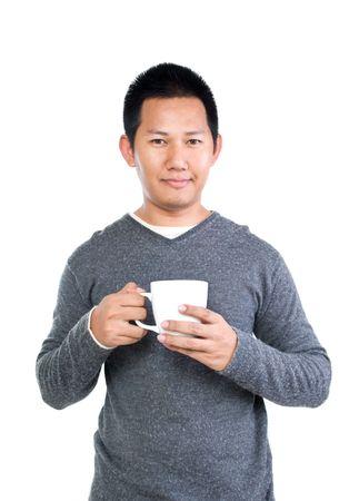 一杯のコーヒーを持っている人 写真素材