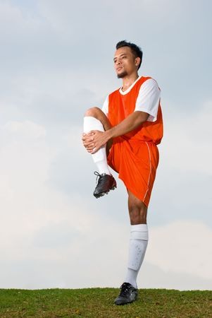 Soccer player warming up