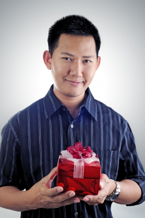 Man holding a present photo