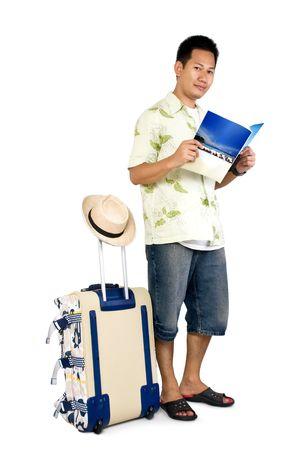 Traveler reading magazine