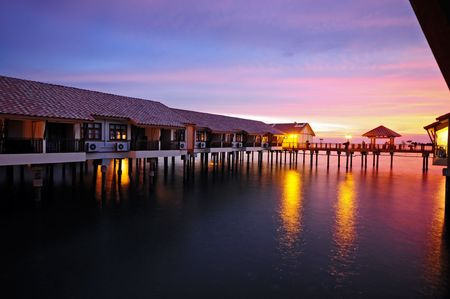Sunset at water houses Stock Photo