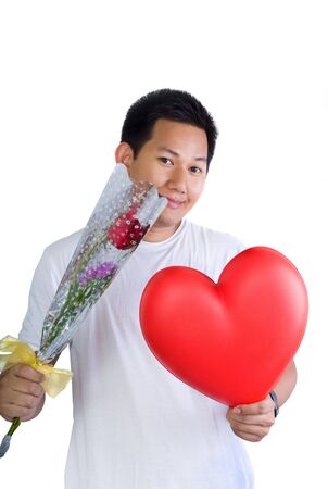 Man holding flower and heart shape photo