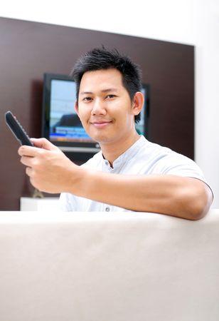 Man watching television photo