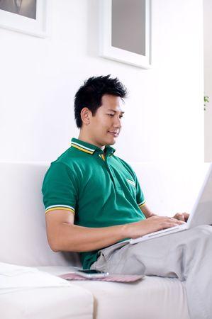 Man surfing internet at home photo
