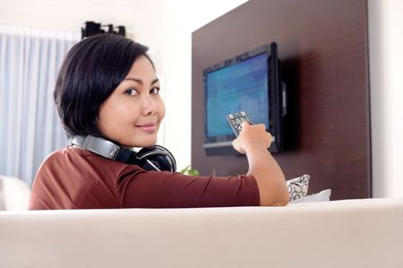 Women watching television Stock Photo