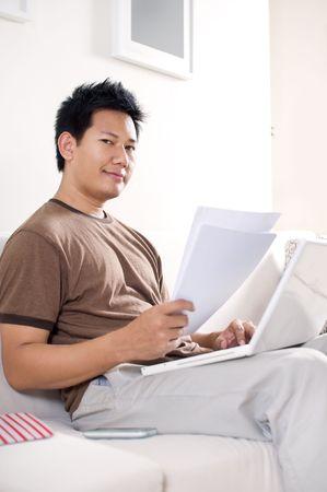 Man doing homework photo
