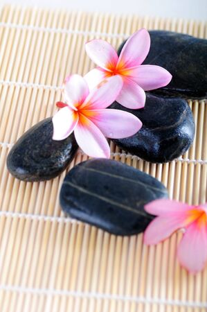 Spa decoration of stones and flowers photo