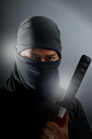 Ninja assassin holding samurai sword photo