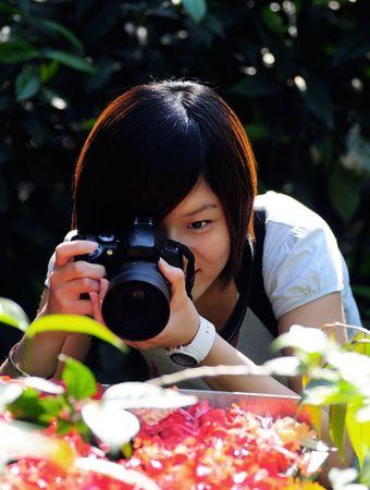 capturing: Women capturing flowers