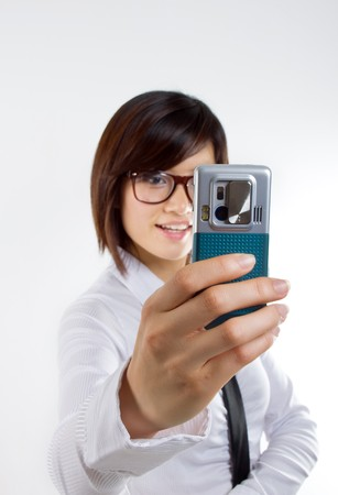 Woman taking picture via cellphone photo