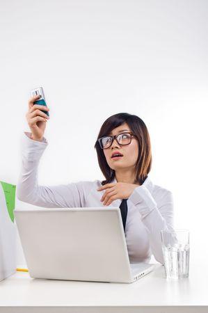 Businesswoman holding cellphone photo