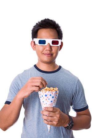 Man watching 3D movies while eating popcorn photo