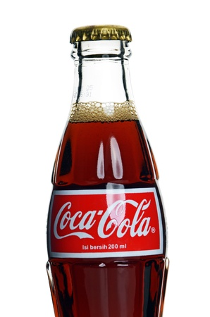 Kuala Lumpur, Malaysia - May, 22 2012: Close up of Coca Cola Coke bottle on white background