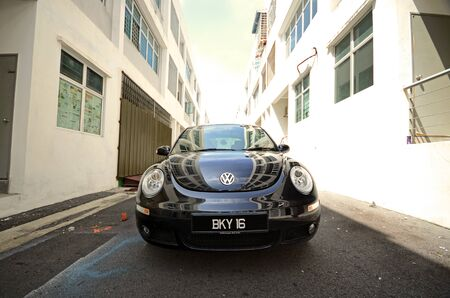 Kuala Lumpur, Malaysia - November, 17 2010: Black volkswagen beetle at the house shop Stock Photo - 13887482