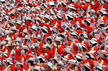 Kuala Lumpur, Malaysia - August, 30 2008: Crowd of Malaysian celebrating Malaysia