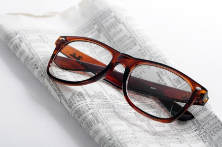 classify: Kuala Lumpur, Malaysia - June, 2 2012: Editorial picture of reading glasses with newspapers   Editorial