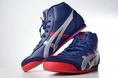 sneakers: Kuala Lumpur, Malaysia - June, 2 2012: Picture of Onitsuka Tiger mid high sneakers
