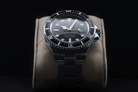 branded: Kuala Lumpur, Malaysia - June, 14 2012: Studio shoot of ROLEX DEEPSEA wristwatch on black background  Editorial