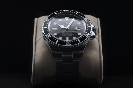 branded: Kuala Lumpur, Malaysia - June, 14 2012: Studio shoot of ROLEX DEEPSEA wristwatch on black background  Editorial