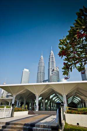 As Syakirin Mosque with Petronas twin towers at the background taken in Kuala Lumpur Malaysia photo