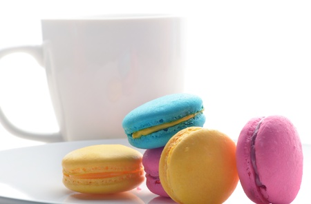 Close up of assorted macaroons with glass of coffee photo