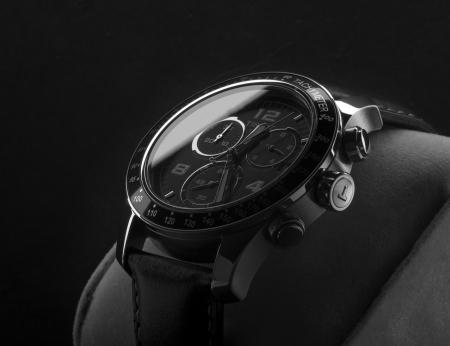 Kuala Lumpur, Malaysia - June, 9 2012: Low light studio shoot of Tissot wristwatch  Editorial