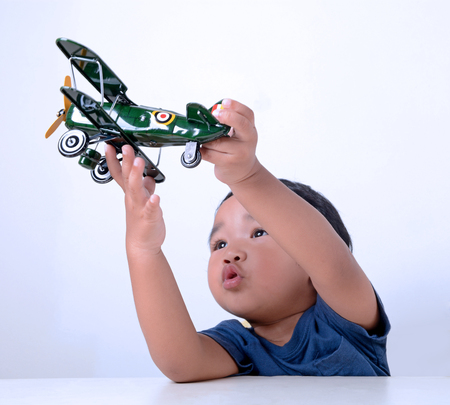 malay boy: Kid play with toy aircraft