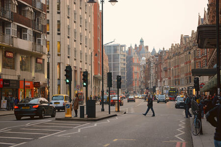 knightsbridge: London, UK - March 28 2014: Brompton Road in Knightsbridge where Harrods building is located