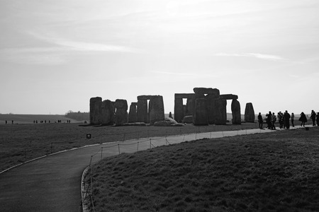 wiltshire: London, UK - March 30 2014: Tourist visiting Stonehenge located in Wiltshire, England. One of the most famous sites in the world.