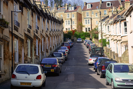 south west england: Bath City, UK - March 30 2014: Car parking along the road beside resident houses.Bath is a city in Somerset located in South West England, 97 miles west of London and 13 miles south-east of Bristol.