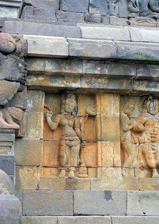 craving: Stone relief craving taken in Borobudur temple in Yogyakarta