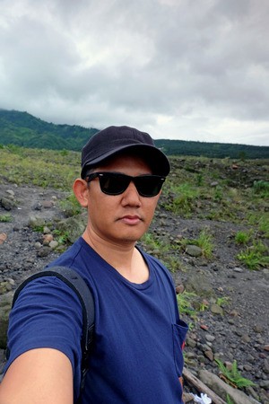 Expedition - man talking a selfie at the mountain landscape photo