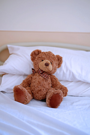 sick teddy bear: Sick teddy bear on the hospital bed