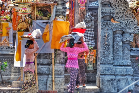 indian culture: Bali, Indonesia - October 27, 2006: HDR picture of balinese women walking to temple carrying ritual food taken at Ubud in Bali, Indonesia
