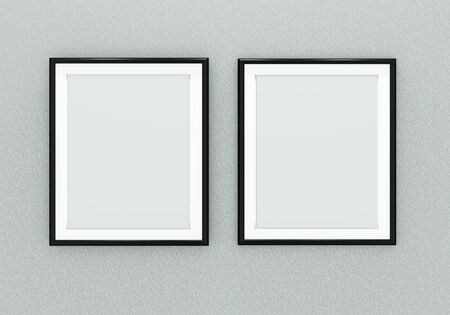Two black picture frames over light grey wall