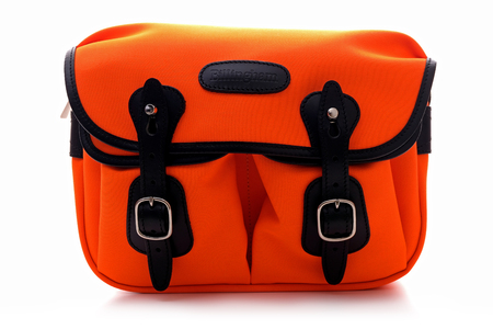 Kuala Lumpur, Malaysia - December 21, 2017: BILLINGHAM HADLEY SMALL bag in Neon Orange with black Leather trim on white background. Billingham bags is a British brand of professional camera bag