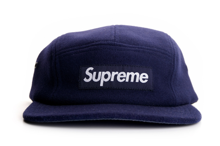 Subang Jaya, Malaysia - Feb 7, 2018: Navy blue Supreme 5 panel cap on white background. Supreme is a skateboarding shop and clothing brand established in New York City in April 1994.