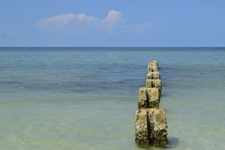 gulf of mexico: Cement pillars covered in barnacles in the Gulf of Mexico at Honeymoon Island State park in Dunedin. Stock Photo