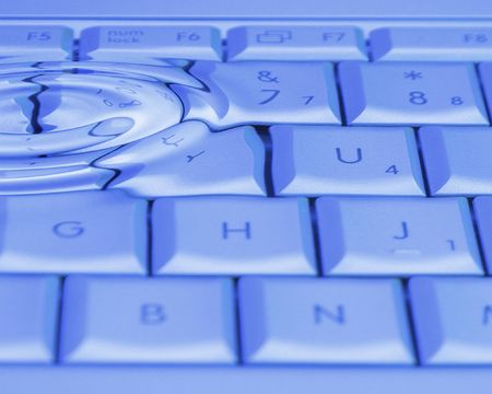 Laptop keyboard with water ripples filter photo
