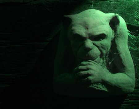 grotesque: Green gargoyle figure