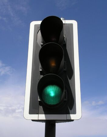 to proceed: Green traffic light Stock Photo