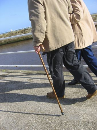 Senior citizens strolling on pier. Stock Photo - 235157