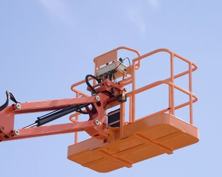 oversee: Hydrolic platform against blue sky Stock Photo