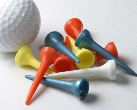 Golf ball and tees on white Stock Photo