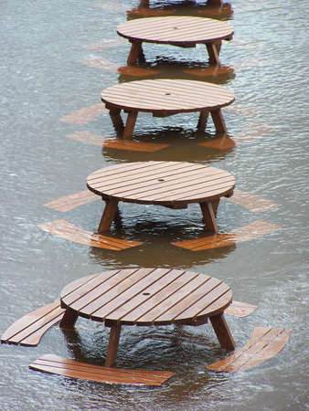 ouse: Flooding of River Ouse, York as a result of heavy rainfall. Photograph shows outside furniture under water.