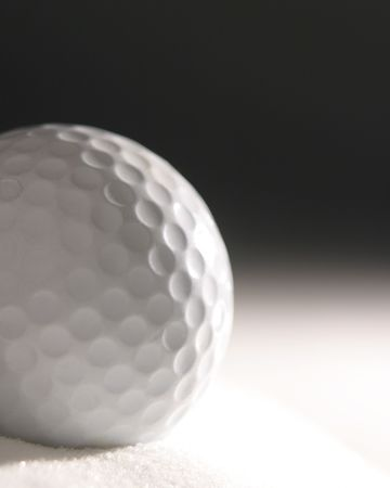 Golf ball in simulated sand dune
