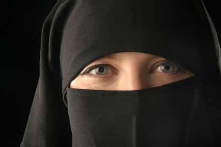 Close-up of caucasion woman wearing black veil. Stock Photo