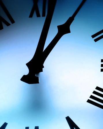 tint: Closeup of clock face with blue tint and lighting effects
